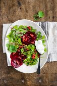 Mixed leaf salad with beetroot and goji berries (top view)