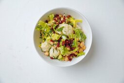 Cauliflower salad with chickpeas, cos lettuce and barberries