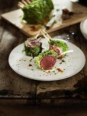 Rare lamb chops in a herb coating