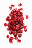 Dried cranberries on a white surface