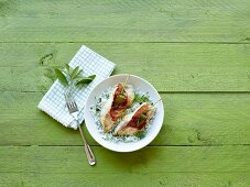 Fish saltimbocca with herb rice