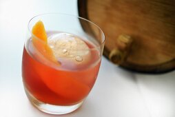 An Old Fashioned cocktail with whiskey from an old barrel
