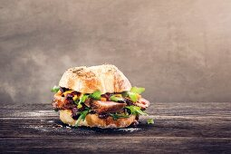 A roll with goose breast, rocket and mango chutney