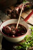 Steaming, cooked beetroot in a saucepan