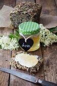 Homemade elderflower jelly on fresh quinoa bread