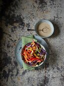 Colourful coleslaw made from vegetable spirals with addressing (seen from above)