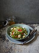 Greek salad made from vegetable spirals with feta cheese