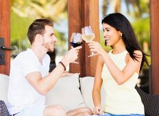 A couple drinking wine on a terrace