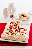 A festive Pavlova with fresh berries and passion fruit