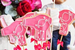 Hairdryer and comb-shaped biscuits with pink icing