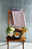 Winter vegetables, figs, and physalis in a wire basket
