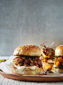 Sesame burger buns with pulled pork and physalis