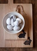 Easter eggs in a bowl with a feather