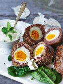 Baked eggs coated in mince for Easter