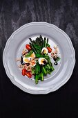 Green asparagus with quail's eggs, shrimps, tomatoes and balsamic cream