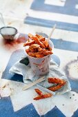 Sweet potato chips in a plastic cup
