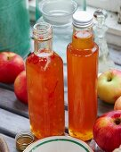 Homemade apple and chilli sauce in bottles