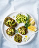 Courgette fritters with an avocado salsa and a coconut dip