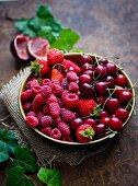 Fresh cherries, strawberries and raspberries in a bowl