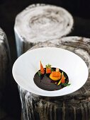 Purple carrot essence with carrot flan and sea buckthorn, restaurant Kai3 in the hotel Budersand, Sylt