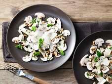 Mushroom carpaccio with pine nuts and Parmesan cheese