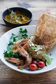 Chicken and prawn curry with slivered almonds