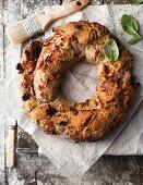 Walnut and bacon flavoured gluten free bread shaped like a wreath