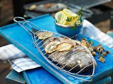 Grilled seabream with an olive and tomato filling