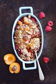 Apricot and raspberry crumble in a baking dish