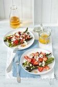 Grilled asparagus with strawberries, feta cheese and orange sauce