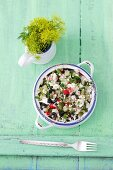 Barley salad with feta cheese, sour gherkins, radishes and black olives