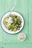 Potato salad with gherkins, leeks and a yogurt sauce made with herbs and hard-boiled egg