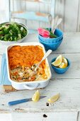 Salmon and cod bake with curried potatoes