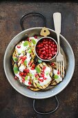Grilled aubergines with yoghurt, pomegranate seeds and peppermint