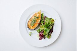 Salmon steak with herb salt and a mixed leaf salad