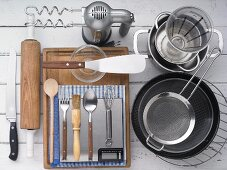 Kitchen utensils for making stuffed yeast dough cakes topped with almonds