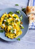 Scrambled eggs with beans and feta cheese