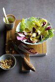 Onion and cheese salad with radicchio and peanuts