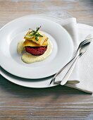 Pan-fried whitefish on beetroot tartare with almond sauce