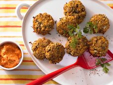 Unripe spelt grain fritters with a creamy pepper dip