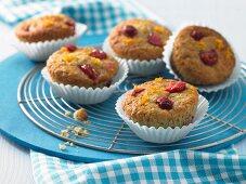 Orange muffins with cherries
