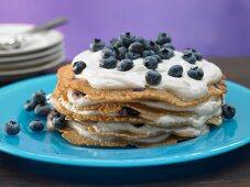 A pancake cake with blueberry quark
