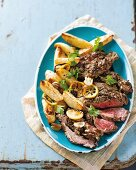 Butterfly lamb shoulder with lemon and potato wedges