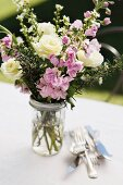 Bouquet of summer flowers decorating garden table