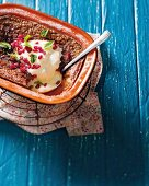 Sharon fruit pudding with cream and pomegranate seeds