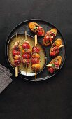 Cherry tomato kebabs and crostini with tomatoes, artichokes and tapenade
