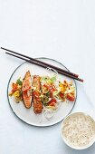 Salmon teriyaki with a cherry tomato, spring onion and rice noodle salad