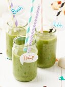 Green smoothies for Halloween decorated with straws and speech bubbles