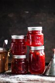 Strawberry jam in screw-top jars