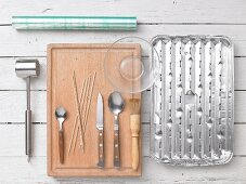 Various kitchen utensils for making grilled food